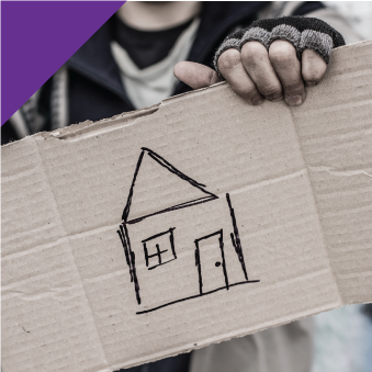 homeless man holding a piece of cardboard with a drawing of a house