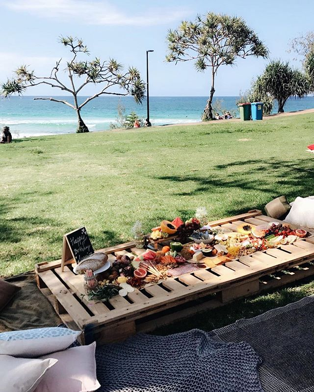 Pop-up Picnic Hire - Beachside picnic hire, we deliver, set up and pack up when finished. So thinking of having an afternoon at Burleigh Hill with friends - we can cater for up to 25 people.Includes hard timber pallets, throws, rugs, and cushions, from $180.Complete the look with one of our platters. *Delivery fee may incur*