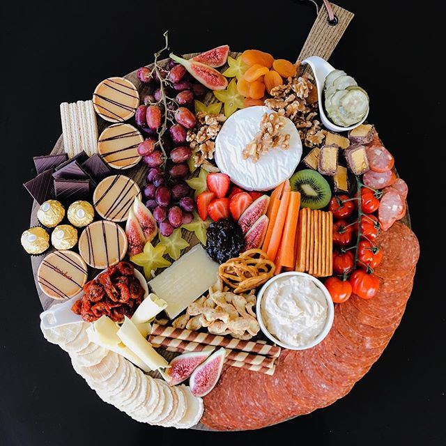 The Afternoon Delights Board - This 50cm board is for the fussy eaters, something for everyone. Ranging from cheeses, dips, caramel tarts, chocolate, seasonal fruits and vegetables, dried fruits and nuts with a touch of caramelised fig paste. Suitable grazing for up 6-8 people, $150 includes cutlery and board hire.