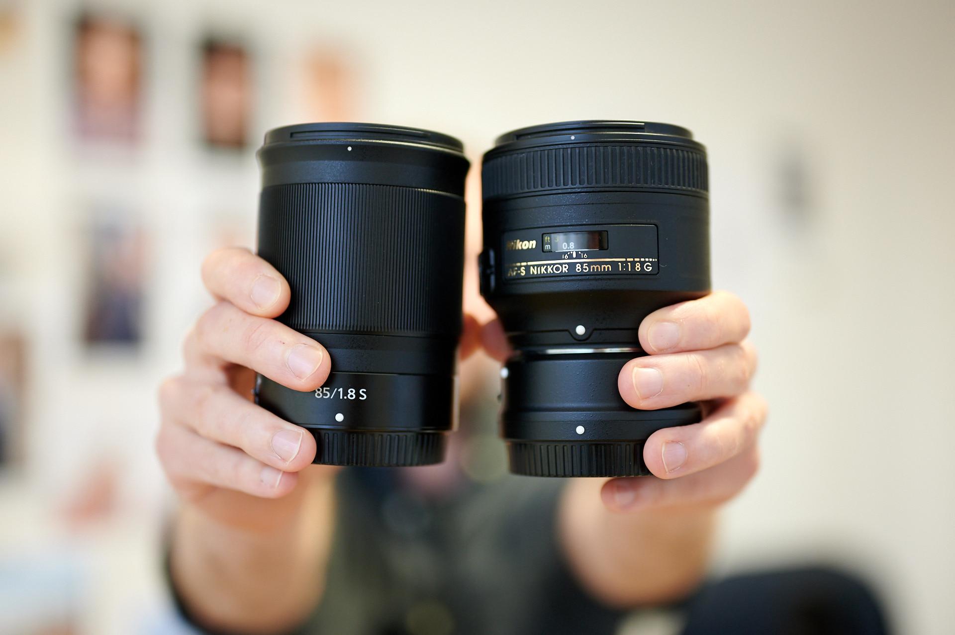 image: Dennis holding the Nikon Nikkor Z 85mm f/1.8S and the AF-S Nikkor 85mm F1:1.8G