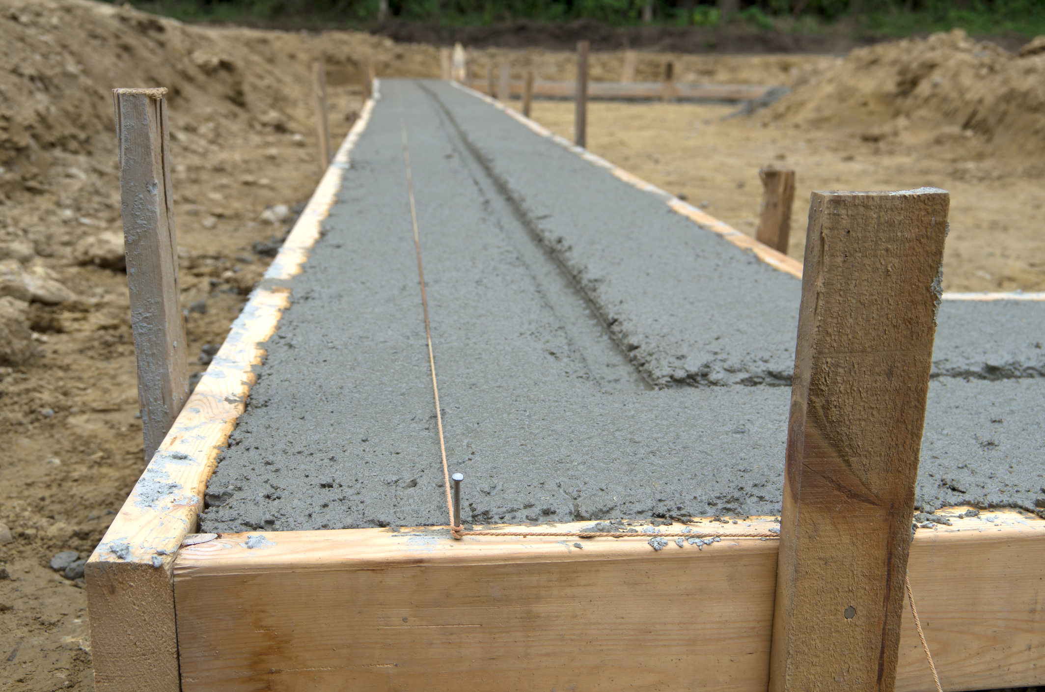 Groundworks - Groundworks - Footings, foul/storm/land drainage & harvesting systems, road construction, concrete floor slabs, concrete finishing & power floating, bulk excavation, lake excavation, agricultural/horticultural & equestrian groundworks.