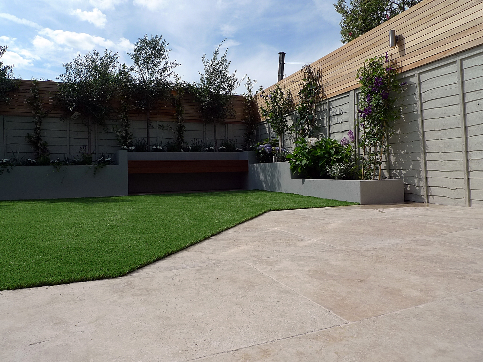 travertine-patio-paving-terrace-fake-easi-grass-floating-hardwood-bench-cedar-screen-trellis-fence-raised-beds-in-grey-dulwich-clapham-balham-battersea-fulham-chelsea-london.jpg