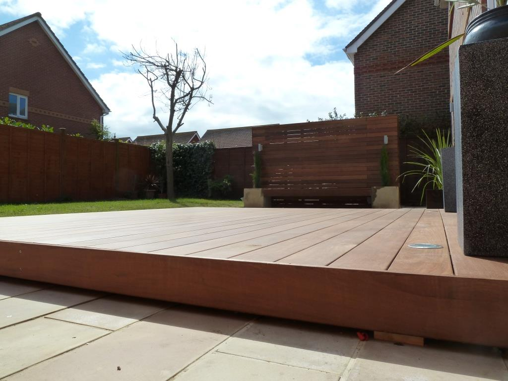 Garden-makeover-with-paving-floating-Ipe-hardwood-deck-vertical-screen-and-planters.jpg