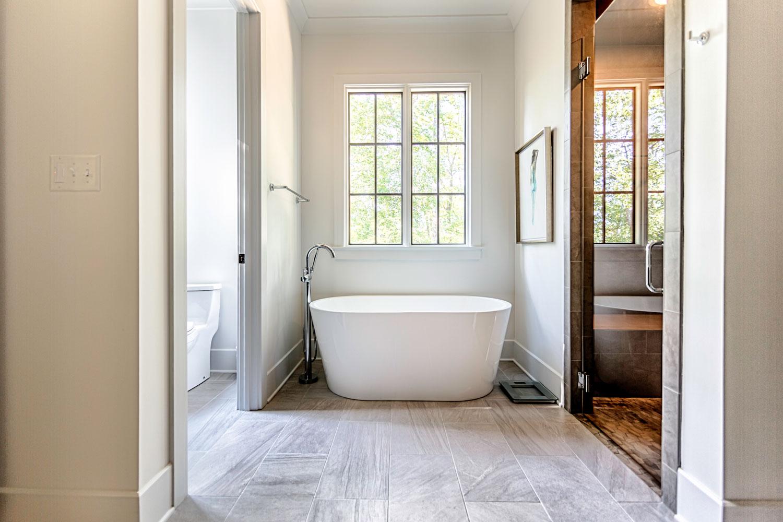 An elegant freestanding tub with chrome tub filler