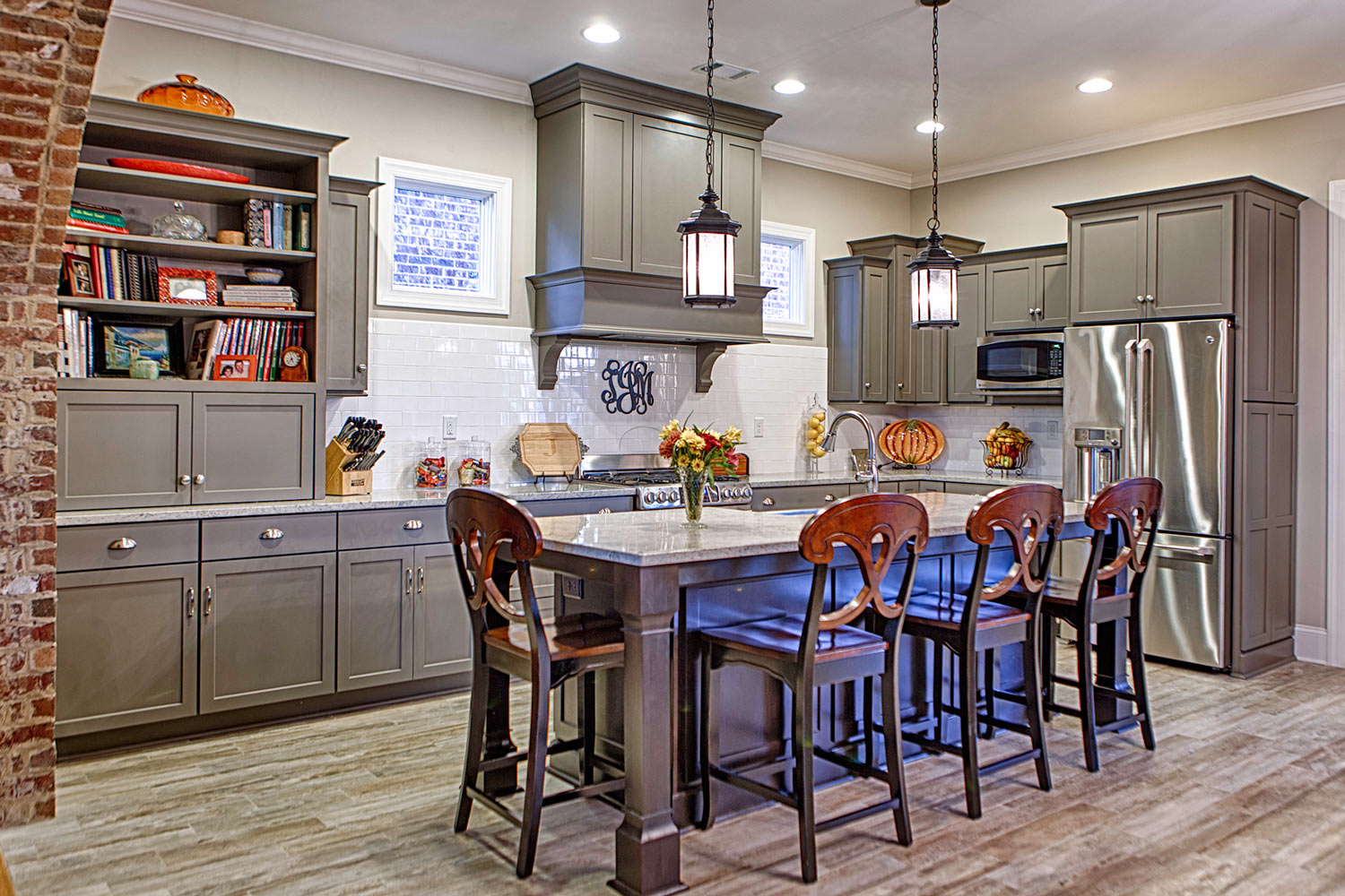 The kitchen island is a stained maple with an old world finish.