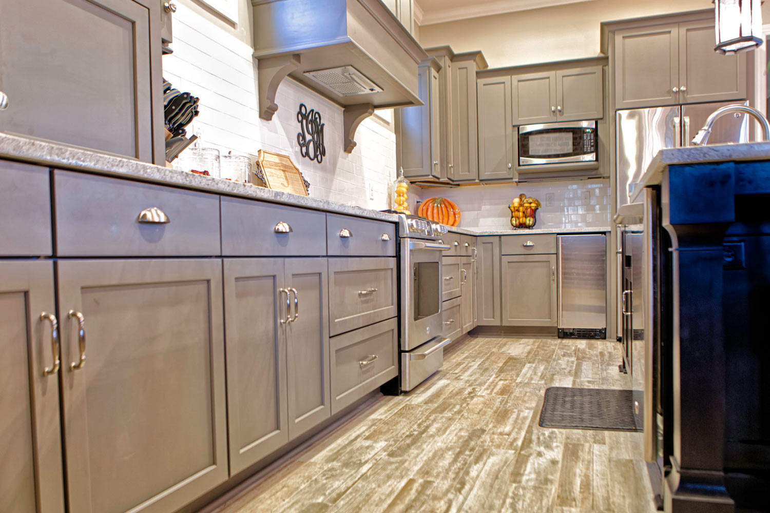 The kitchen cabinetry is by Integrity. It is a semi-custom design.