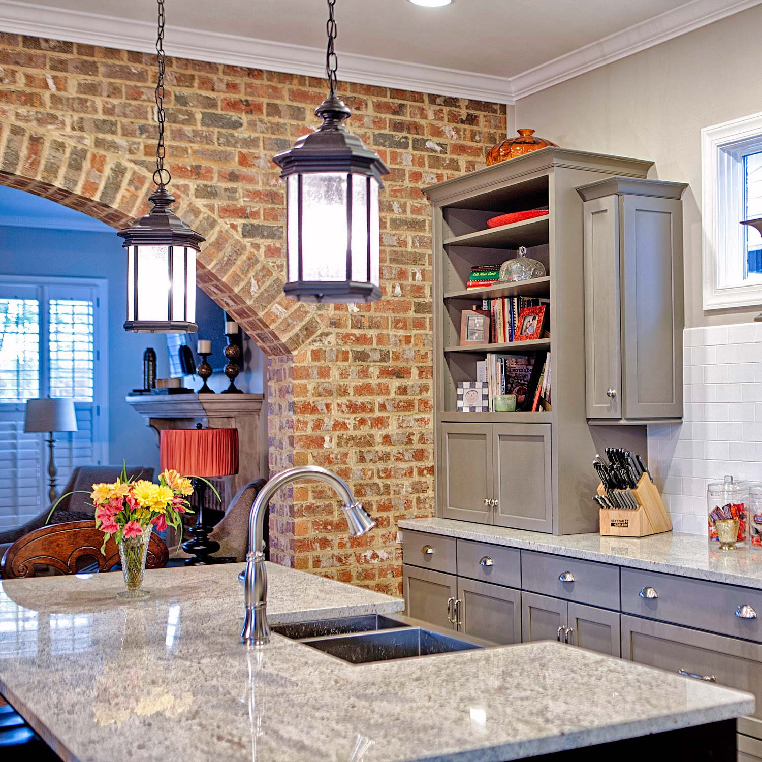 This moderately priced kitchen was built to evoke the carriage house style of New Orleans or the loft spaces found in Chicago.