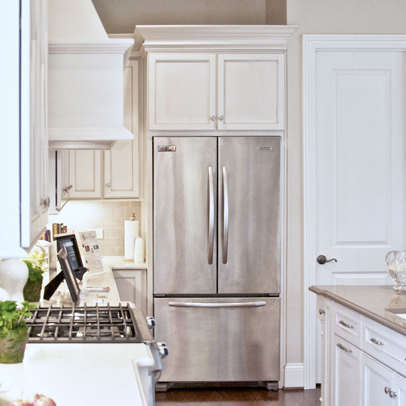 "Custom cabinets with a full overlay with ""X"" mullions,"