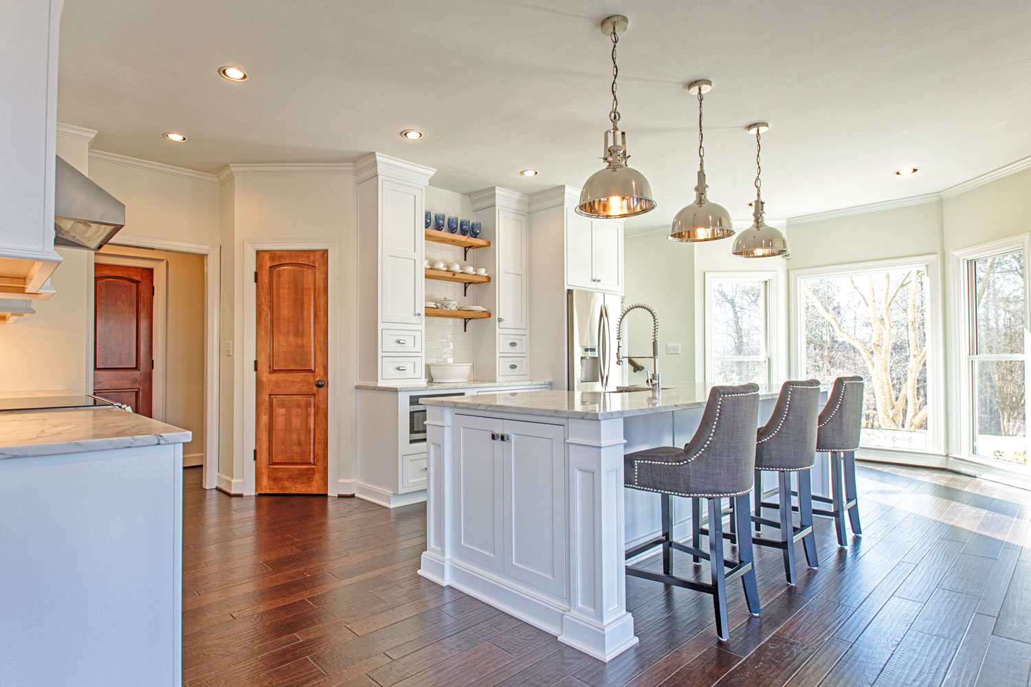 Recessed canned lighting on a dimmer switch provides ample light for this space.