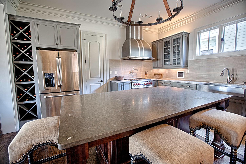 Floor to ceiling diamond shaped wine bins.