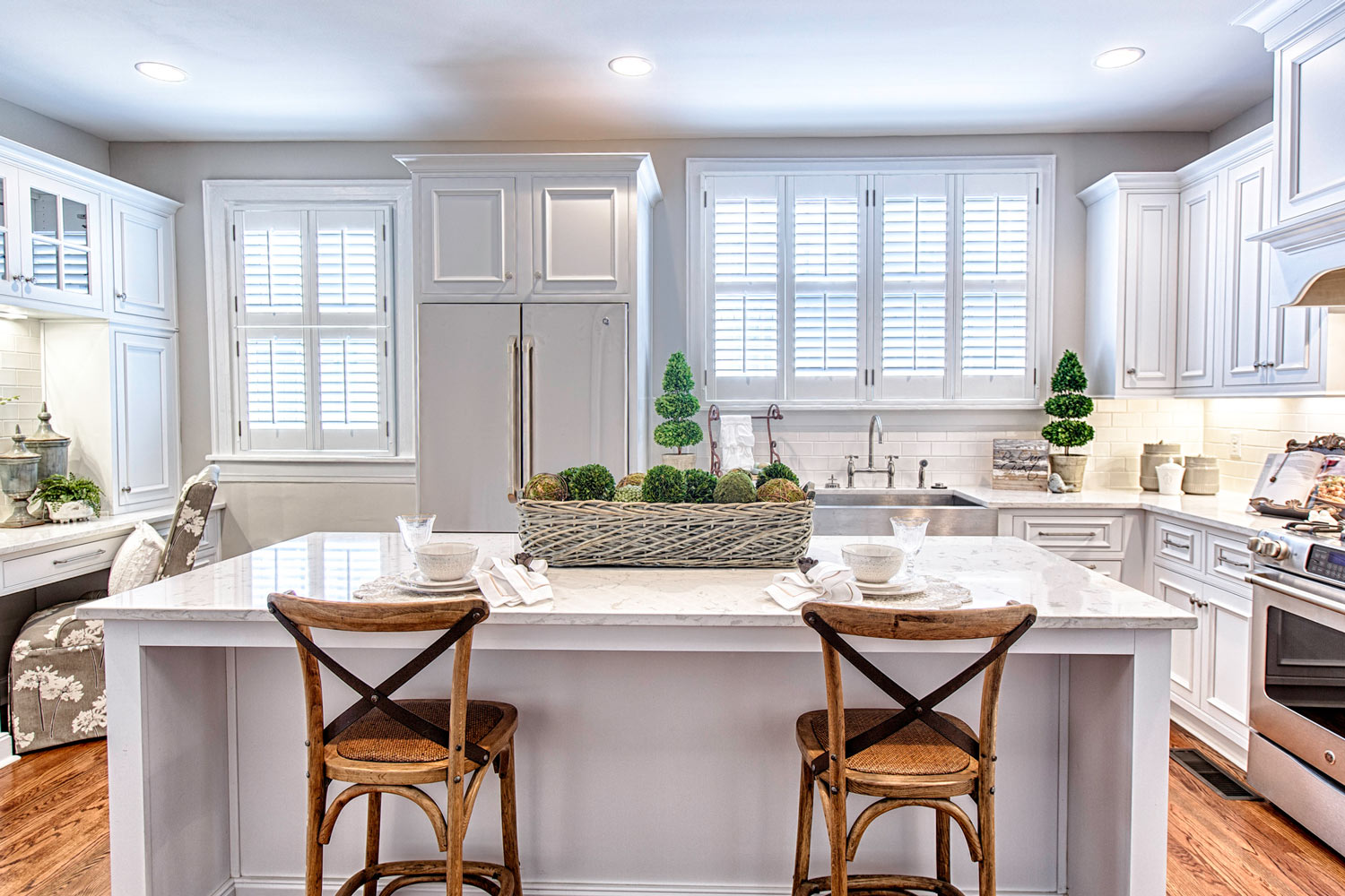Plain white cabinets with a beaded inset and a flat panel cabinet door.