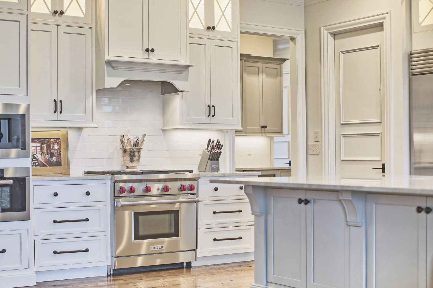 """This traditional kitchen has a professional 36"""" Wolf range and steam oven."""