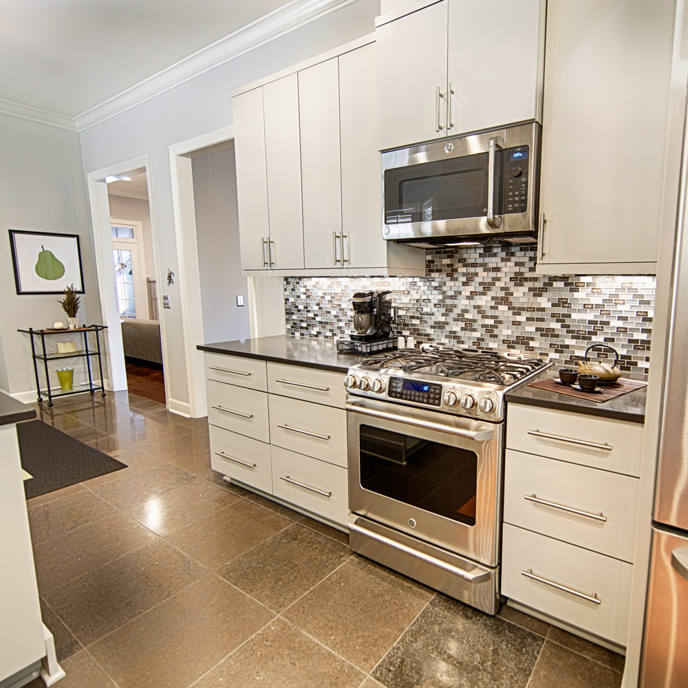 GE Cafe appliances were used in this modern kitchen remodel.