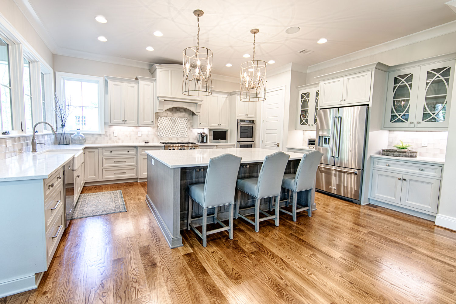 This new construction transitional kitchen has wide plank oak floors and Sierra Pacifc Windows