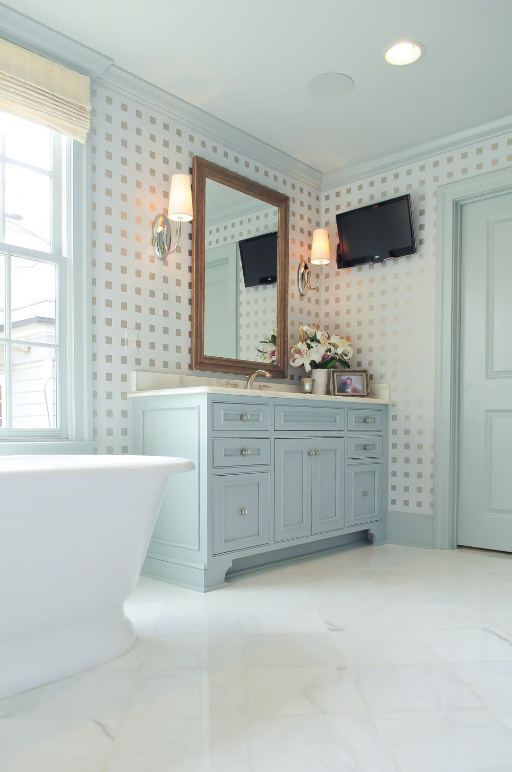 Heidi's Interiors who choose the color palette and wallpaper for this project.