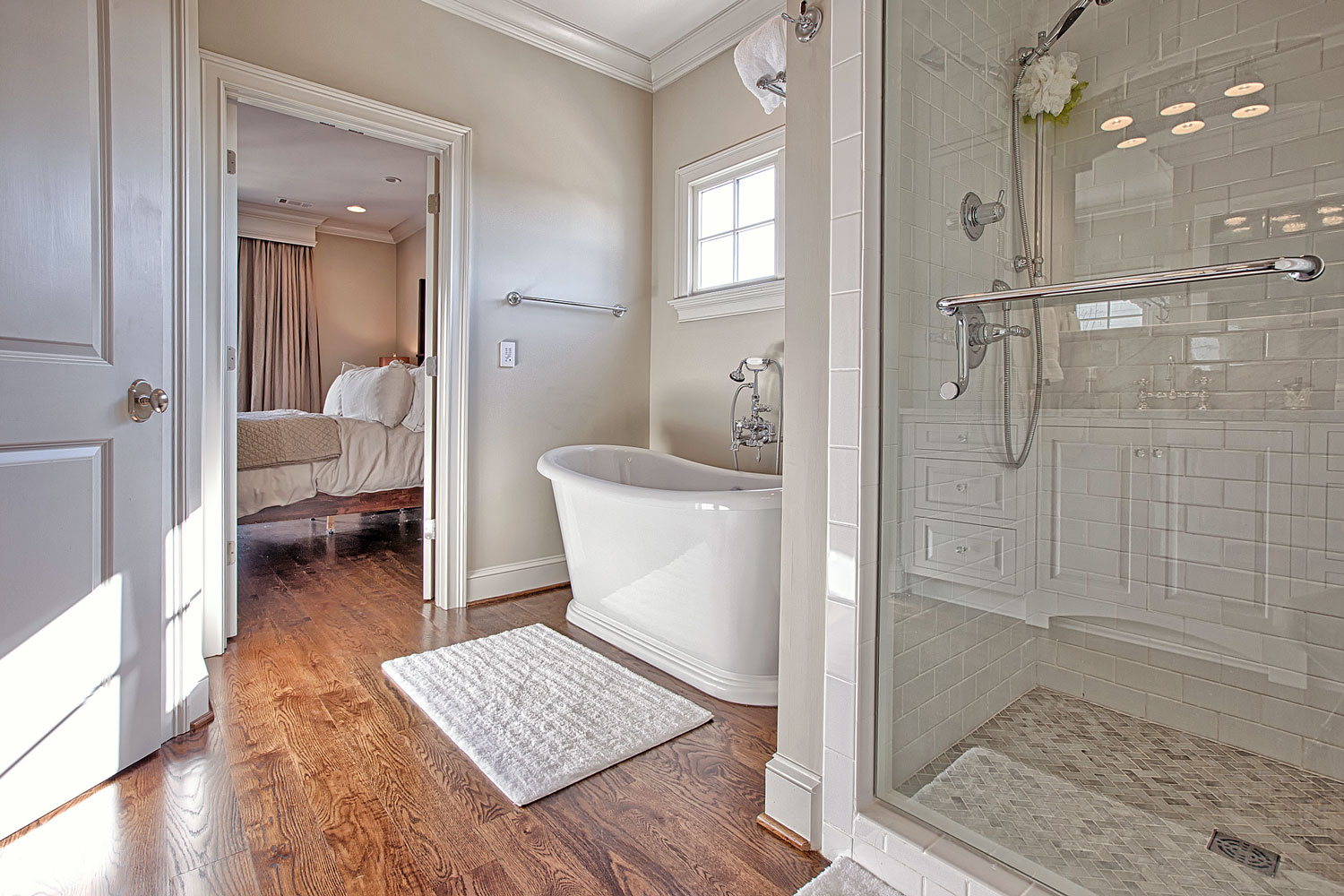 A traditional bathroom is located within a home in a historic district of Tuscaloosa, AL.