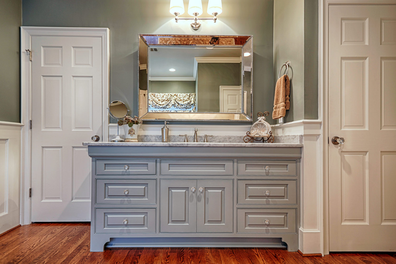 A classic look is created with custom beaded inset gray cabinets.