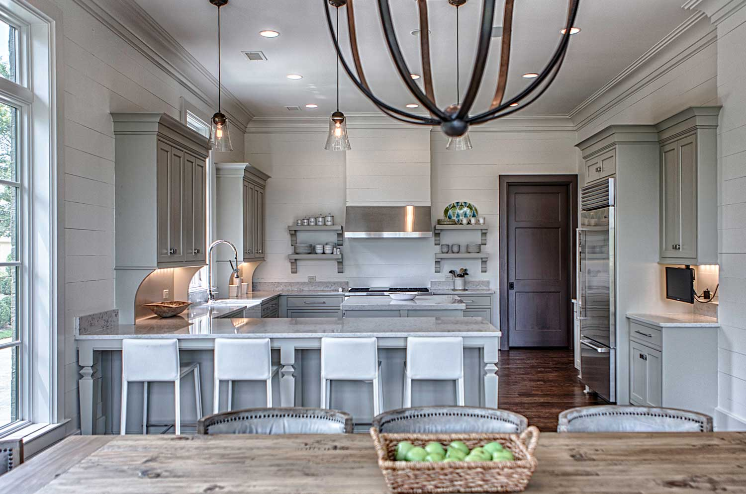 The dining table in the foreground was sourced from Restoration Hardware.