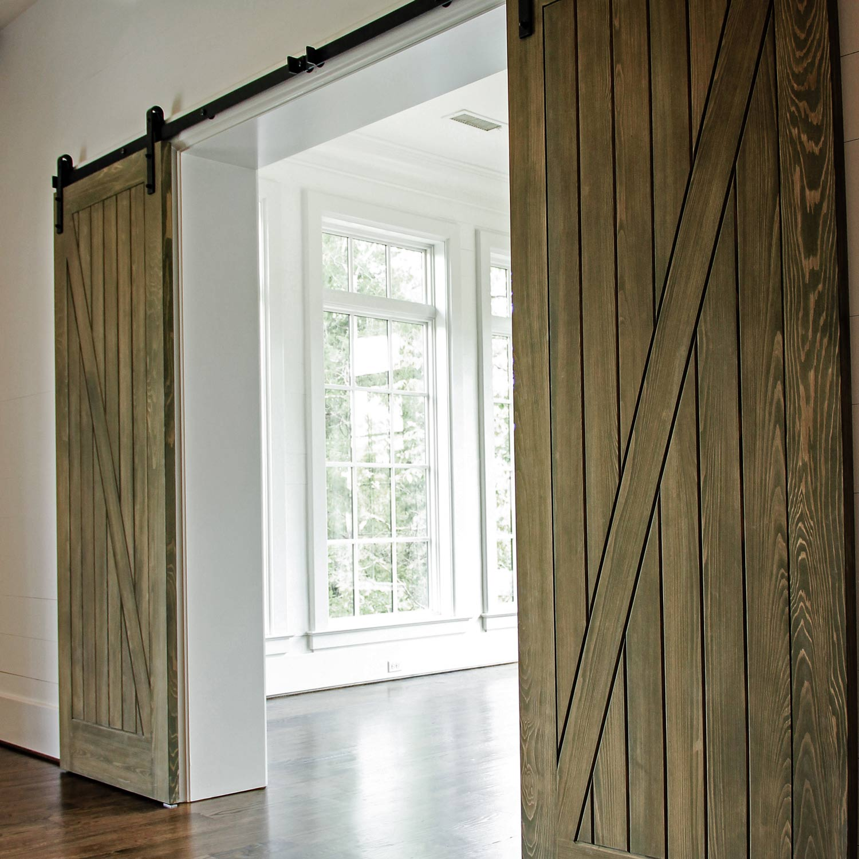 Barn door entryway to the dining room.