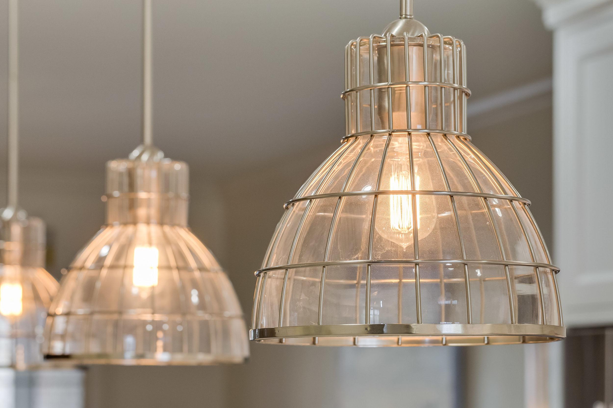 Wire cage lighting fixtures in satin nickel.