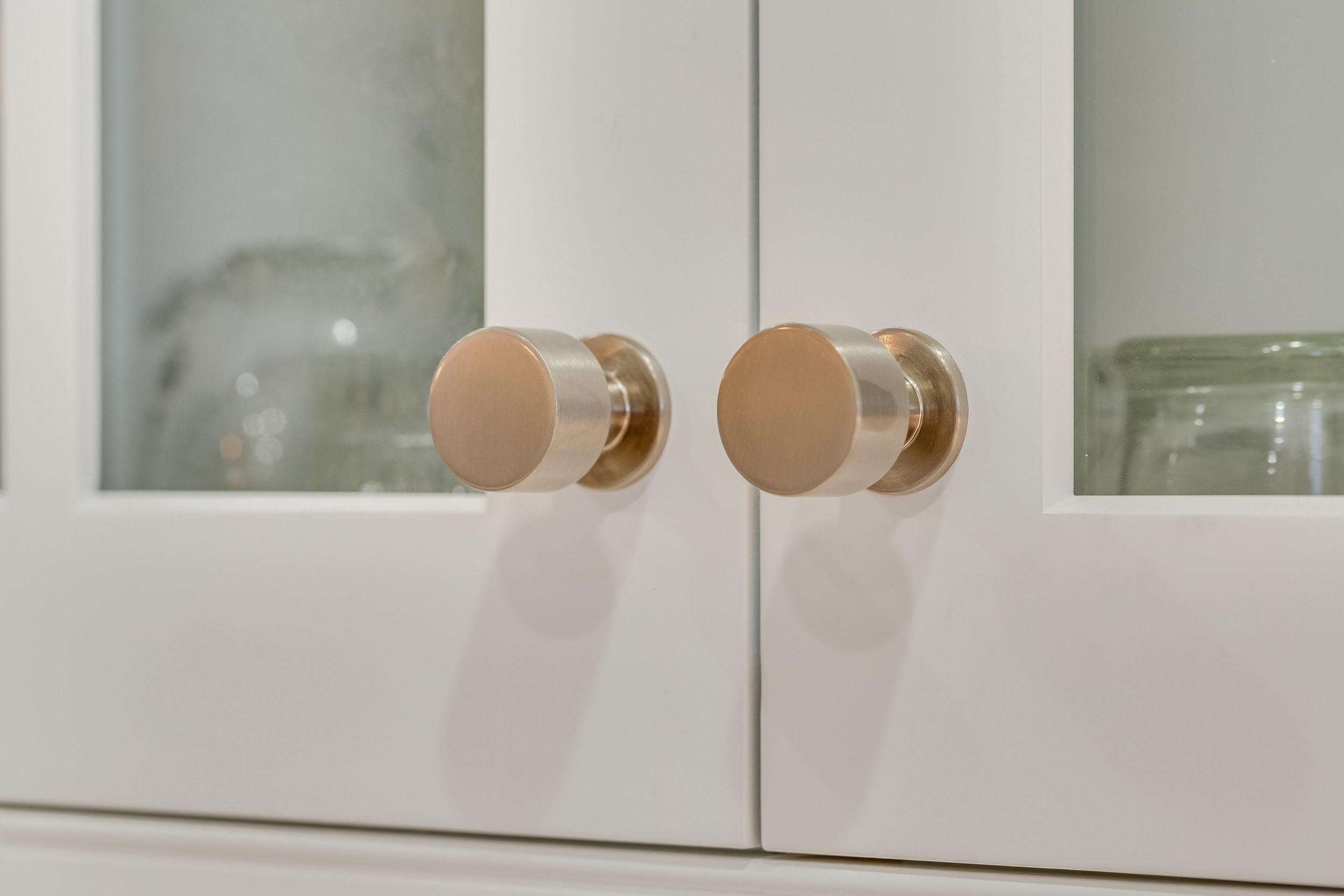 Satin nickel upper cabinet hardware knobs by Top Knobs.