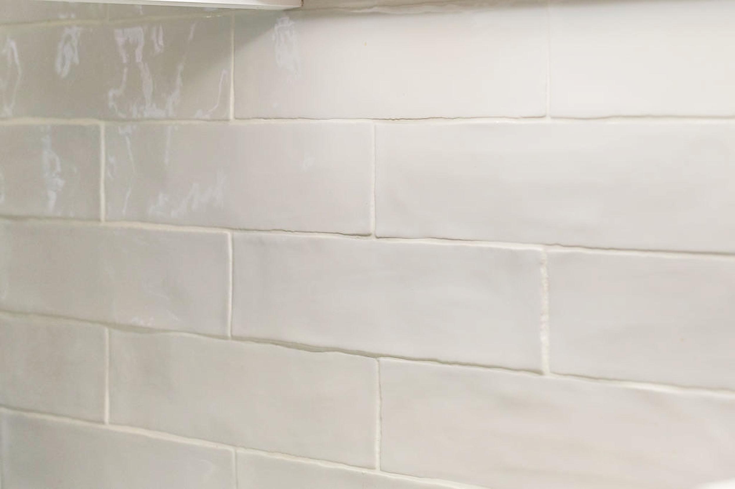 """Handmade white 3"""" x 12"""" subway tiles by Speartek Tile & Stone."""