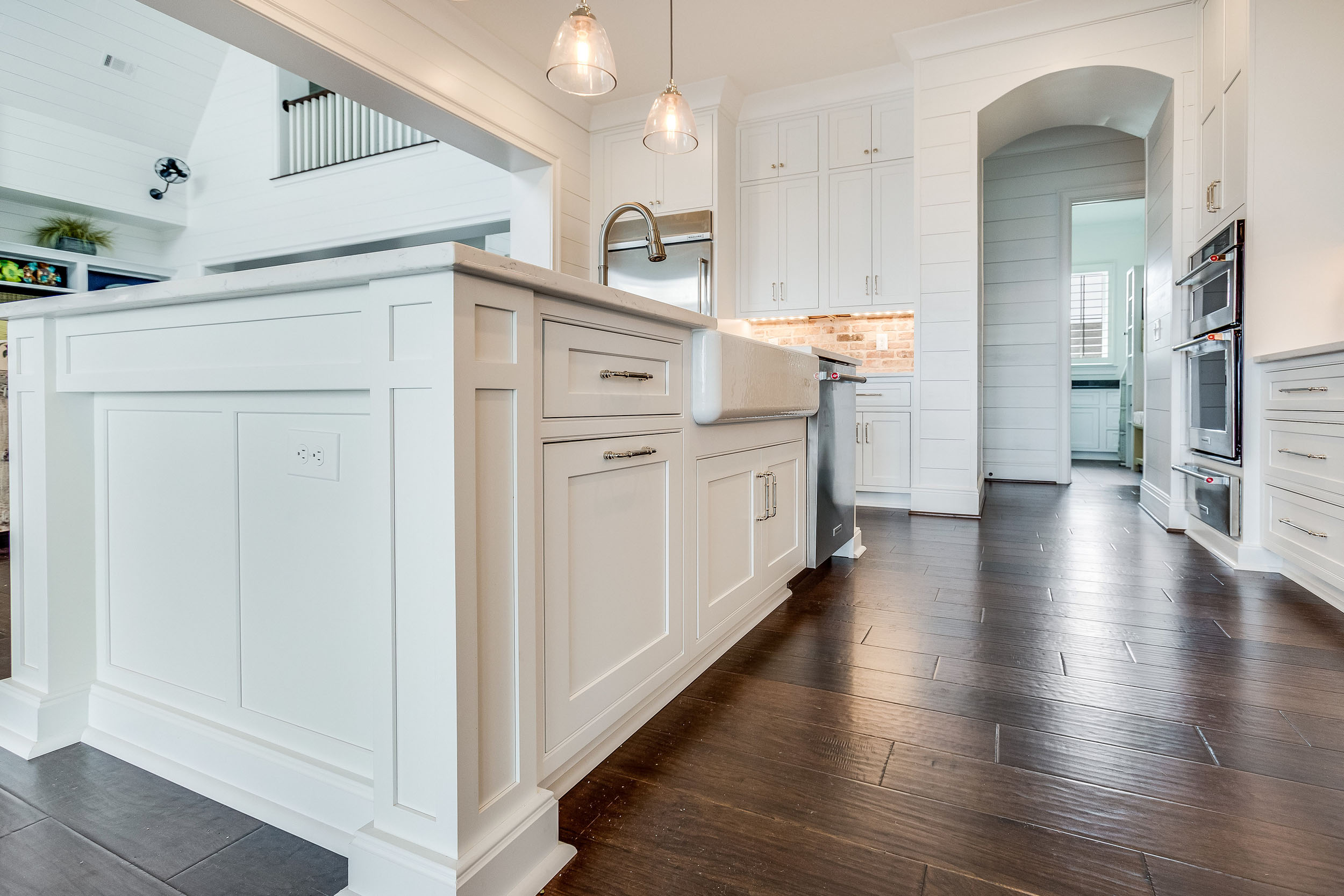 The end of island cabinetry has custom details.