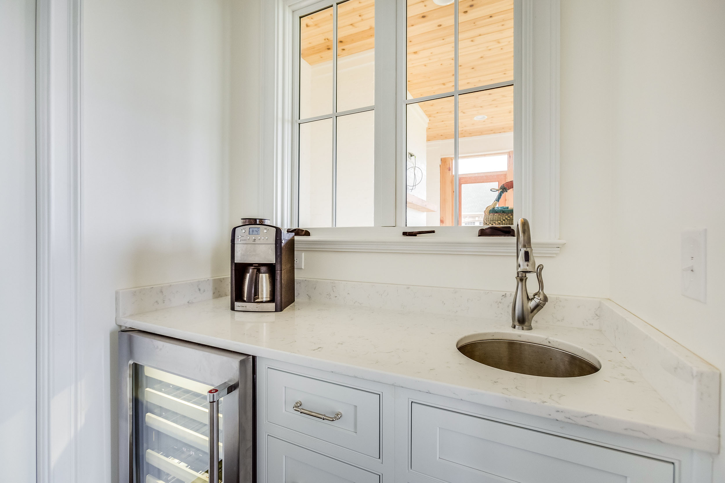 The pantry has french casement windows creating a pass through to the outdoor living space.