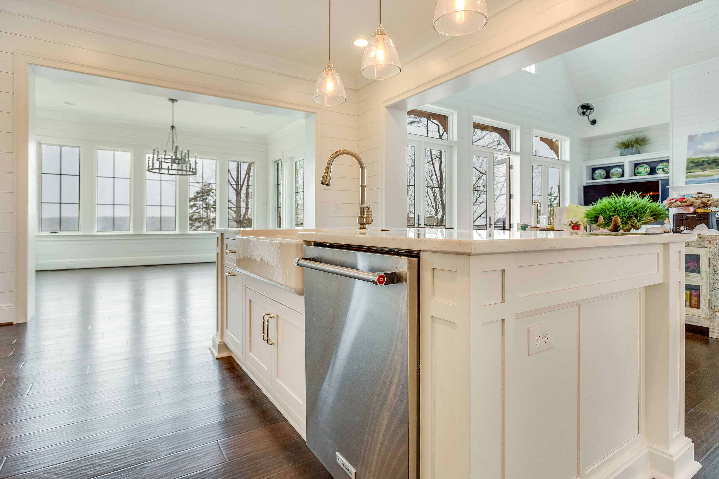 The dishwasher by Kitchenaid is placed within the island.