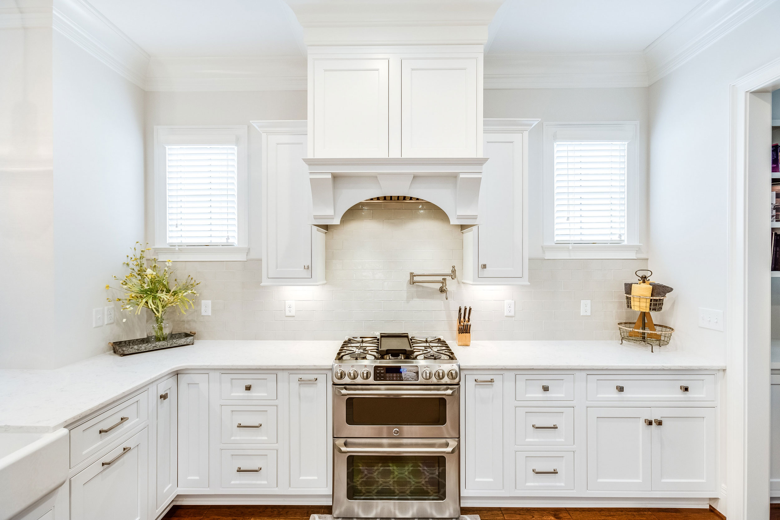 The custom range hood acts as a focal point in this kitchen.
