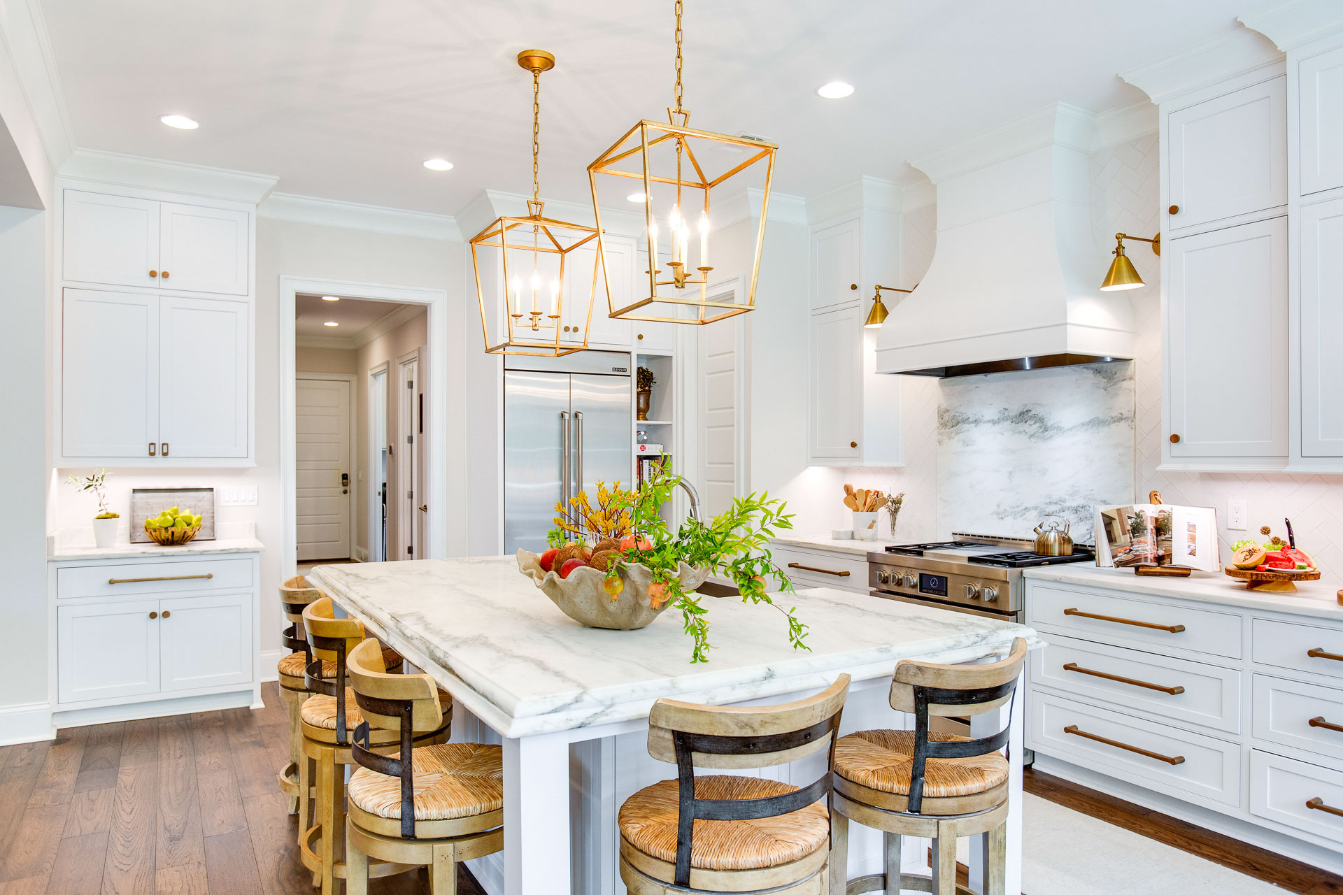 The kitchen island chandeliers are by Gabby Lighting.