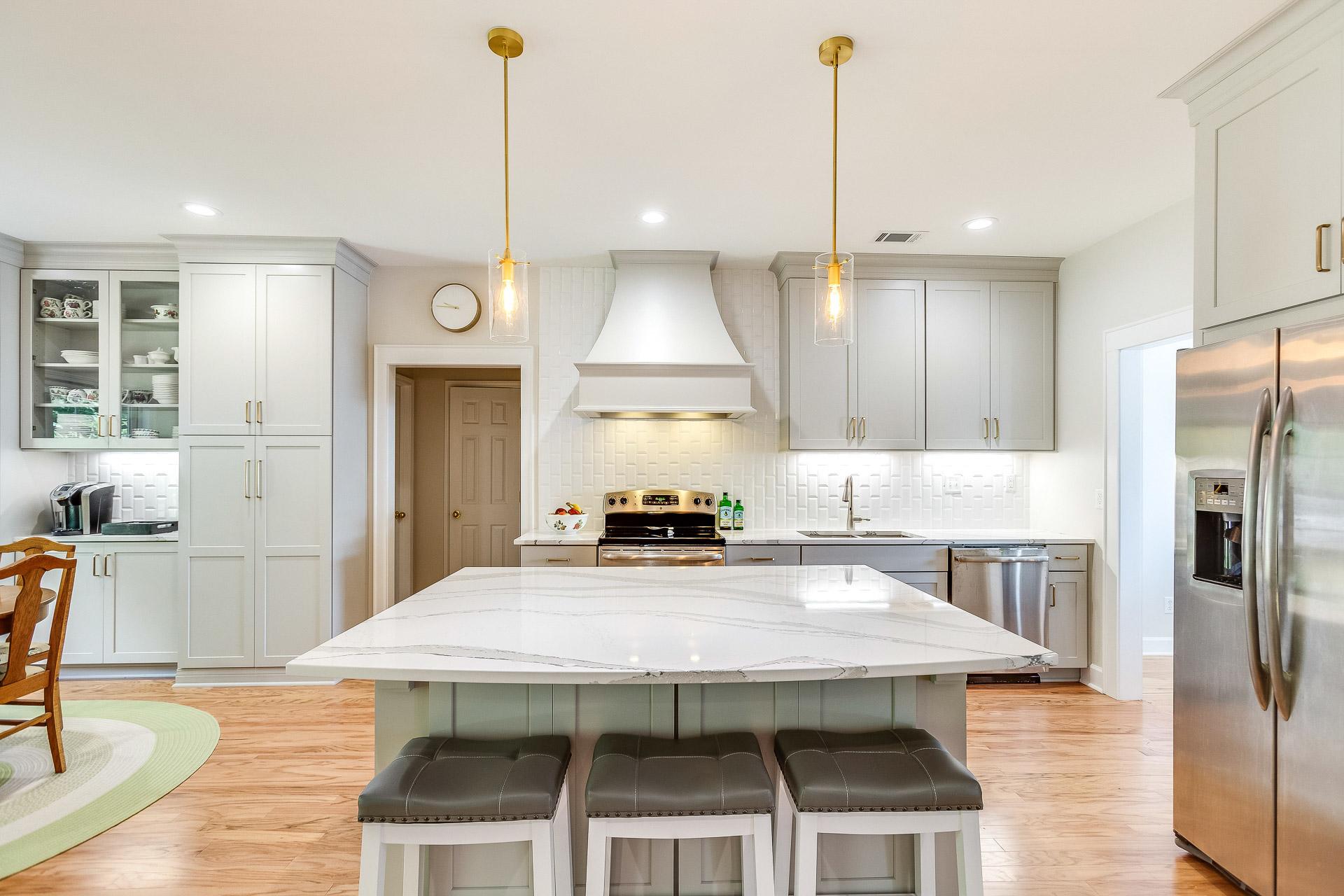 An open concept kitchen with a large Cambria Britannica quartz kitchen island countertop.