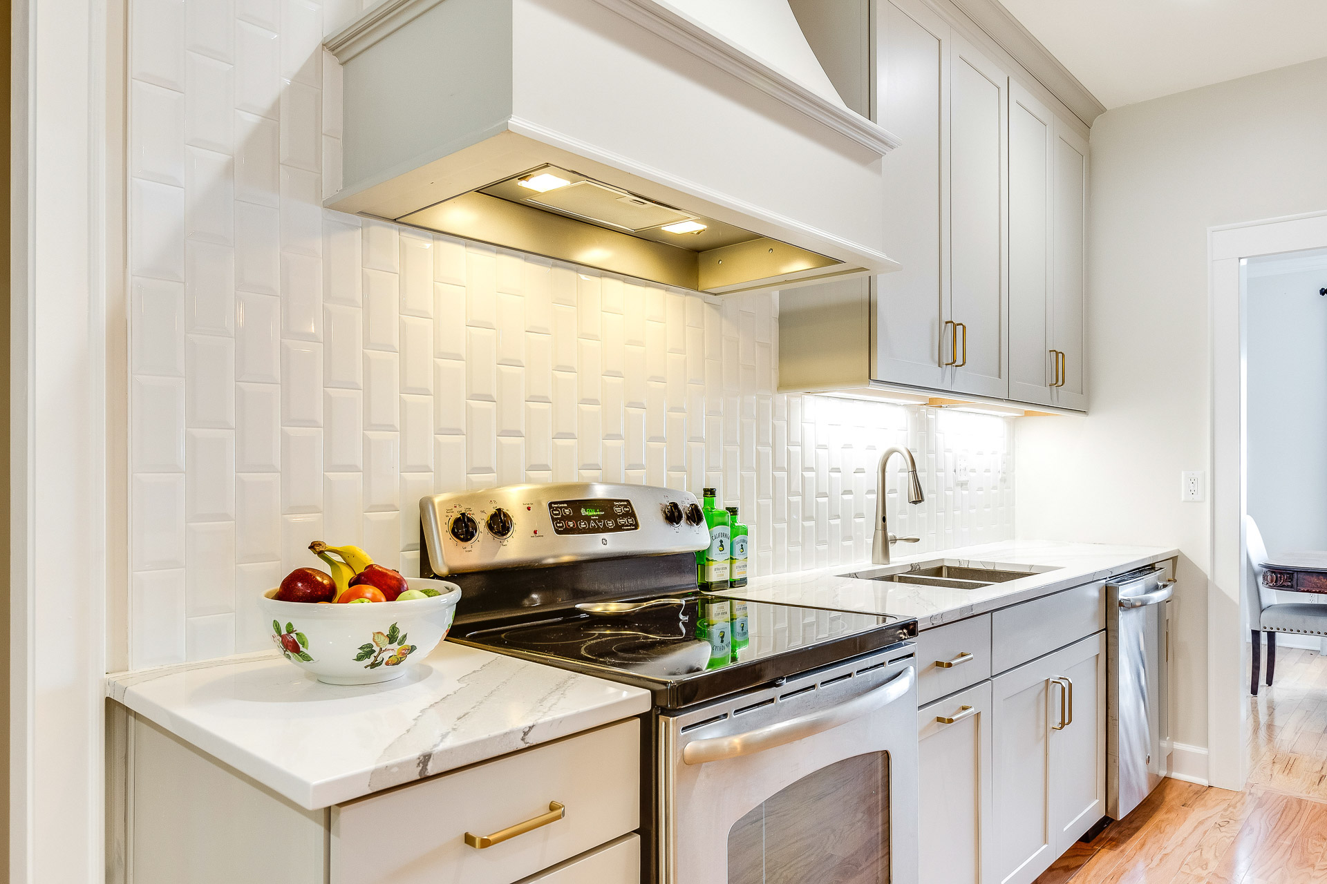 Under cabinet lighting by Task was used in the work areas and in the range hood.
