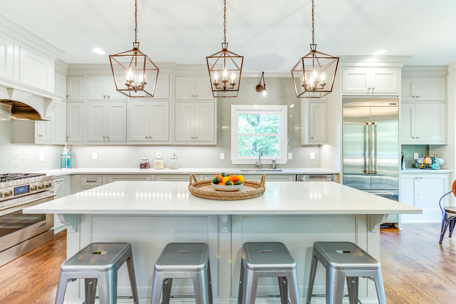 The kitchen island and surrounding countertops are Dupont Zodiaq quartz in London Sky.