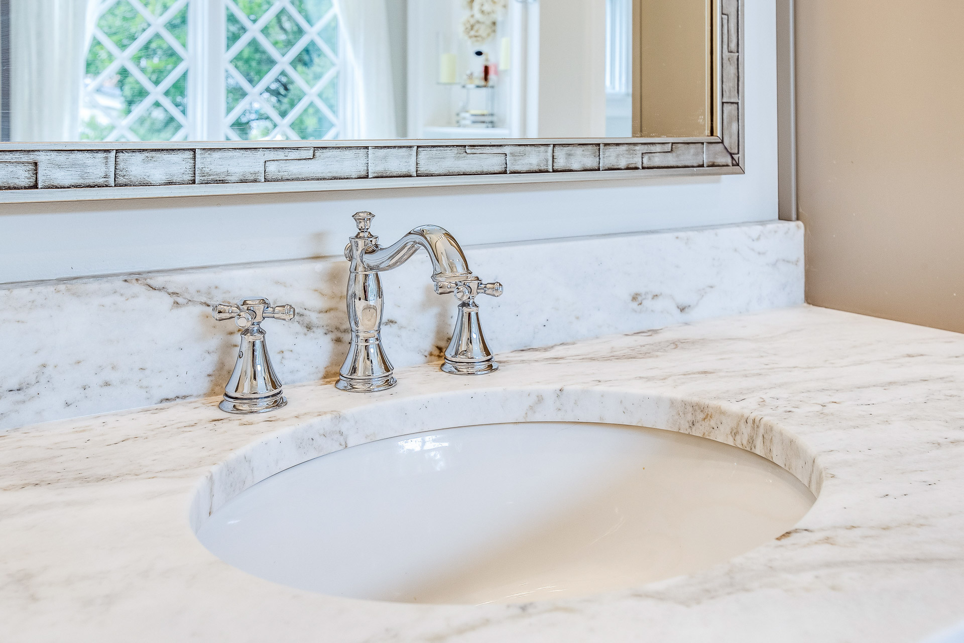 Castro White marble countertops on the bathroom vanity.
