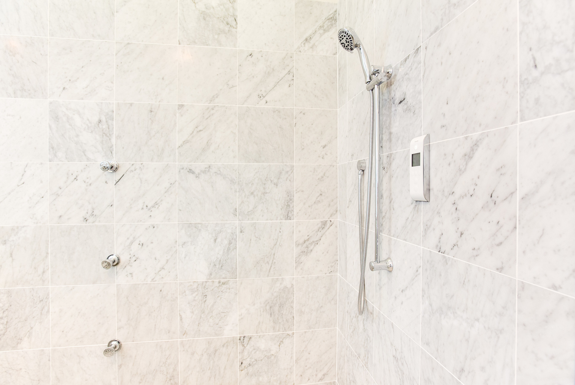 "The shower hardware is Kohler's Digital DTV ""Behind The Wall"" system."