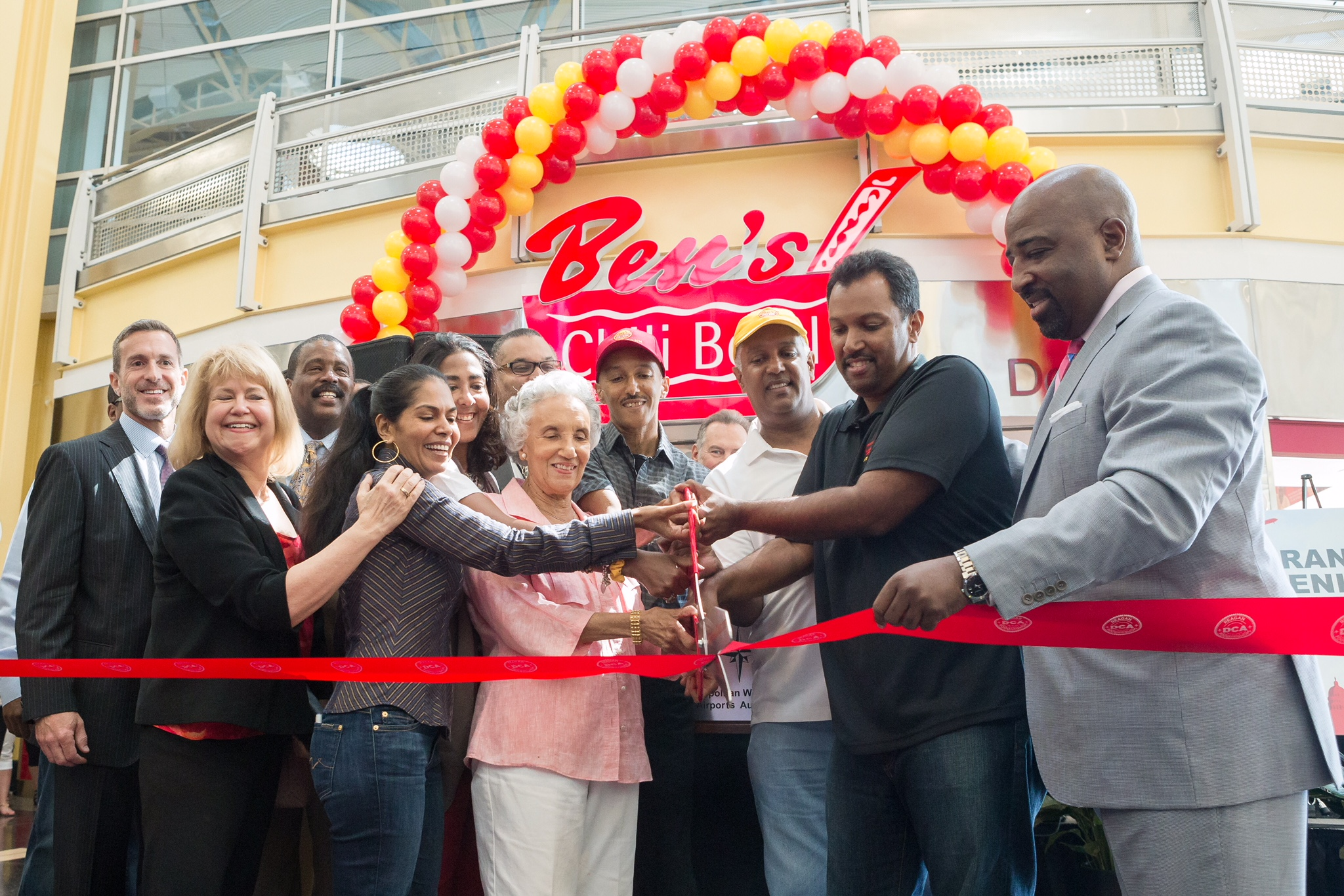Clarene LeJeune with owners of Ben's Chili Bowl at their grand opening in Reagan National Airport.