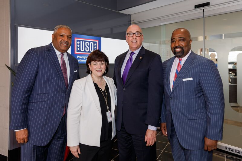Mel Hannah ( Executive Vice President of LeJeune and Associates ), Chellie Cameron ( CEO of PHL ), Joseph Brooks ( President/CEO of USO of Pennsylvania and Southern New Jersey),  and Clarence LeJeune ( President/CEO of LeJeune and Associates ) at the opening of USO's First-Class Lounge for members of the military and their families at PHL.