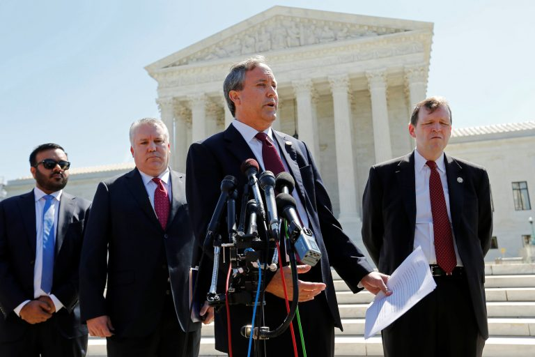 Texas Attorney General Ken Paxton (2nd R) holds a news conference at the Supreme Court building in Washington, U.S. June 9, 2016. REUTERS/Jonathan Ernst