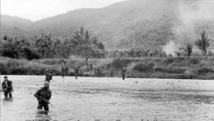 Alpha Company soldiers crossing river crossing near Bong Son, photo by Robert Matulac.