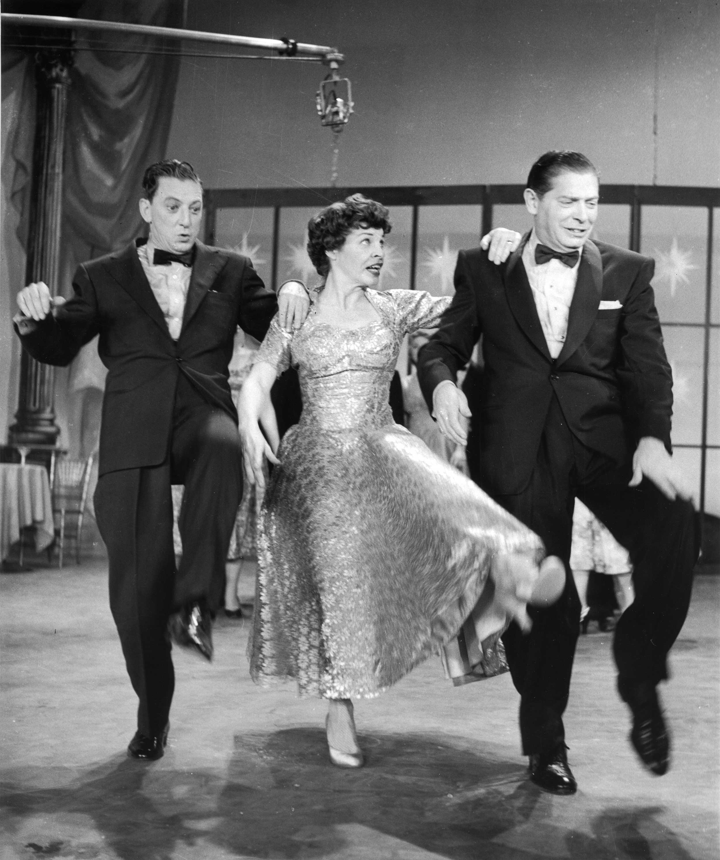 Martha Raye with Ray Bolger (left) and Milton Berle.