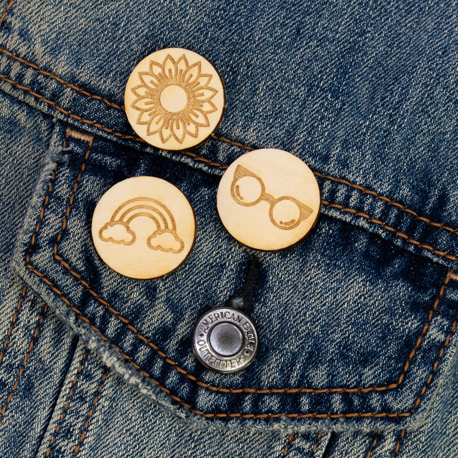 Laser engraved lapel pins on a jacket