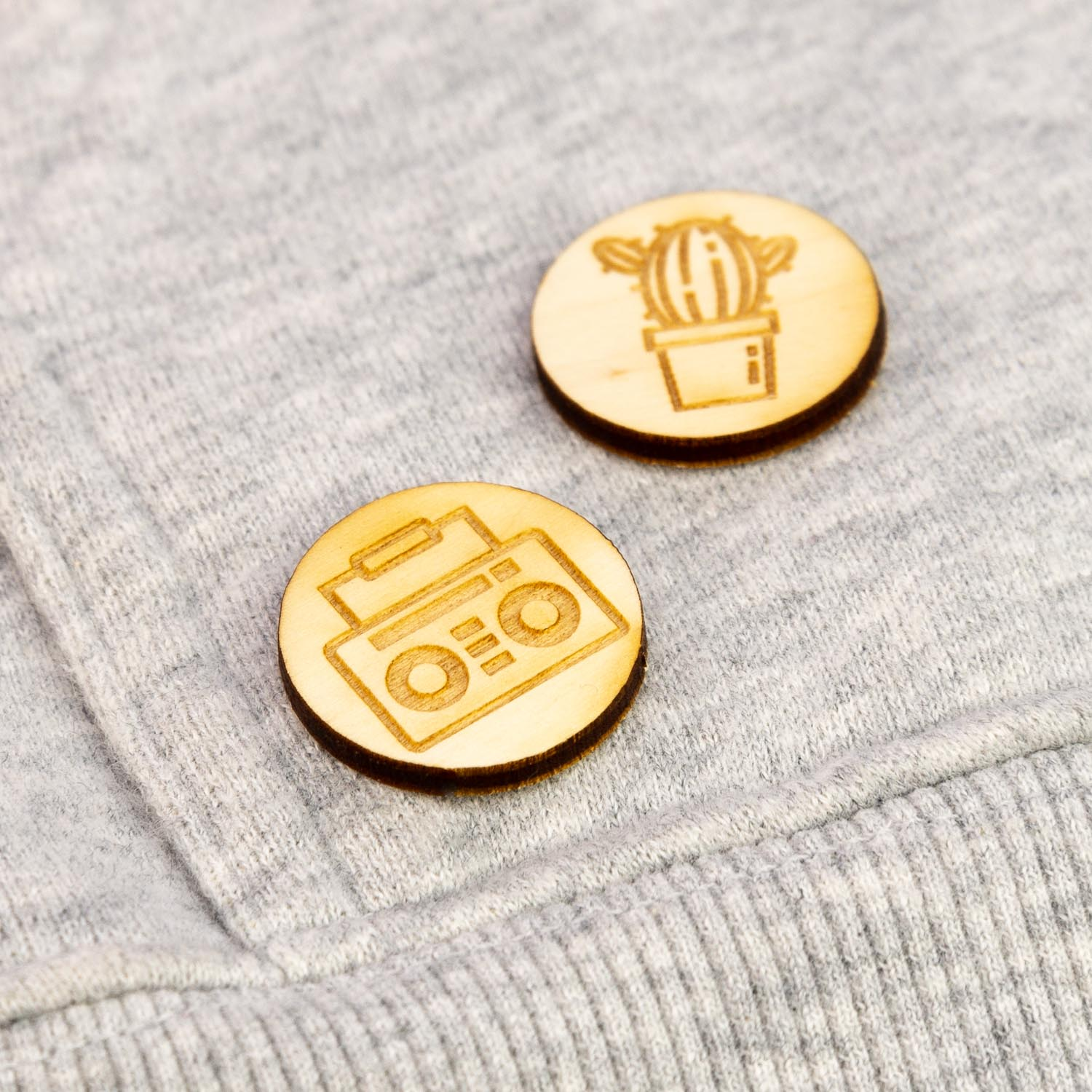 Laser engraved lapel pins on a sweater