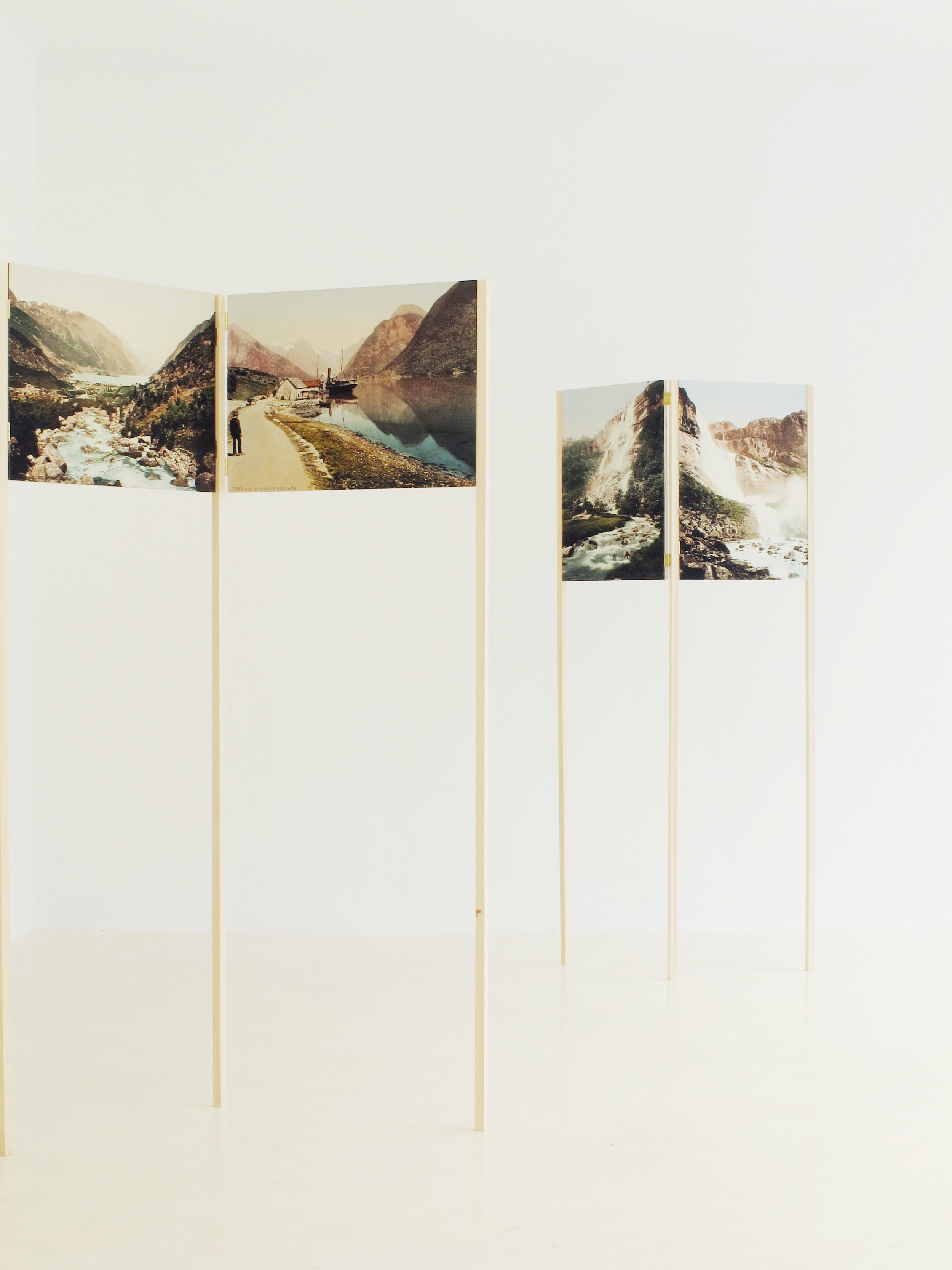Where the Mountains are Pink  (2013) Photo reproductions of prospects in the box named  Diverse Landskap. PZ Farger  ( Various Landscapes. PZ Colours ), by unknown photographers. In the courtesy of Preus Museum Inkjet on hot press fibre paper, mounted on wood  Photo: Randi Grov Berger/Entrée Installation view at Entrée