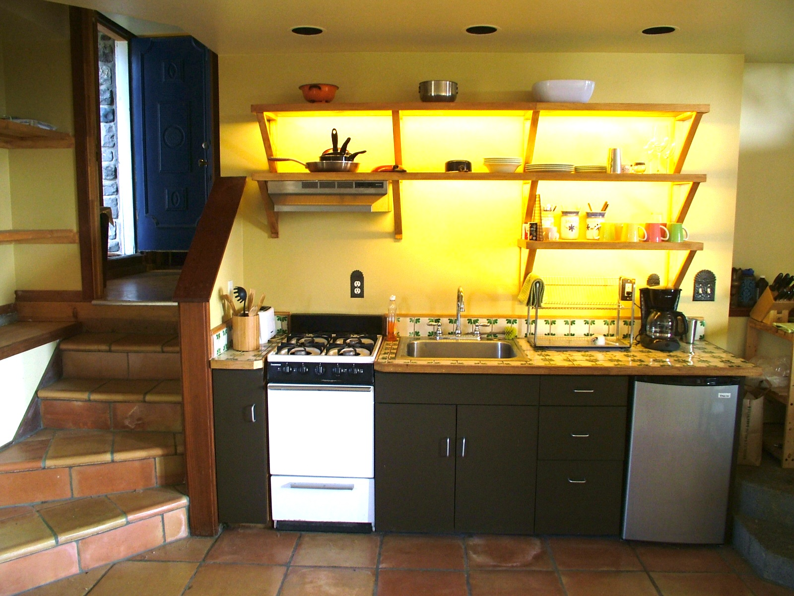 Kitchenette in Cottage with Mexican Tile motif.
