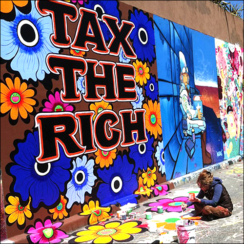 "Megan Wilson, painting her mural ""Tax The Rich"", Clarion Alley, San Francisco, CA, 2013"