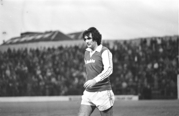 George Best playing for Hibernian of Edinburgh, the first Scottish side to use a kit sponsor--Greater Manchester area sports apparel company Bukta.