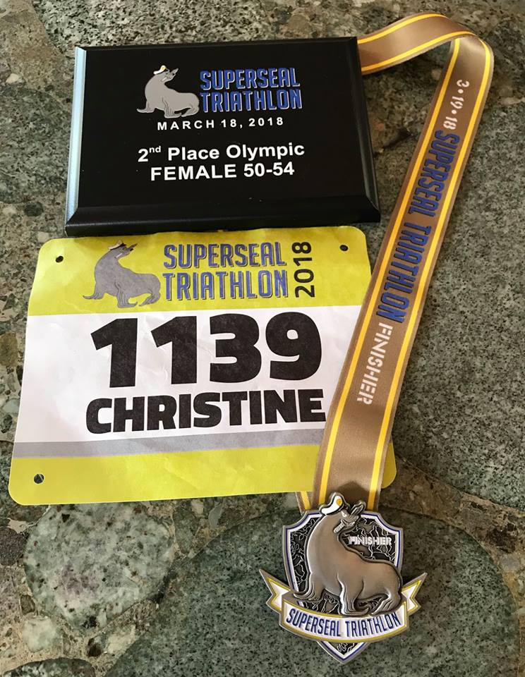 Finish medal, bib, and plaque.