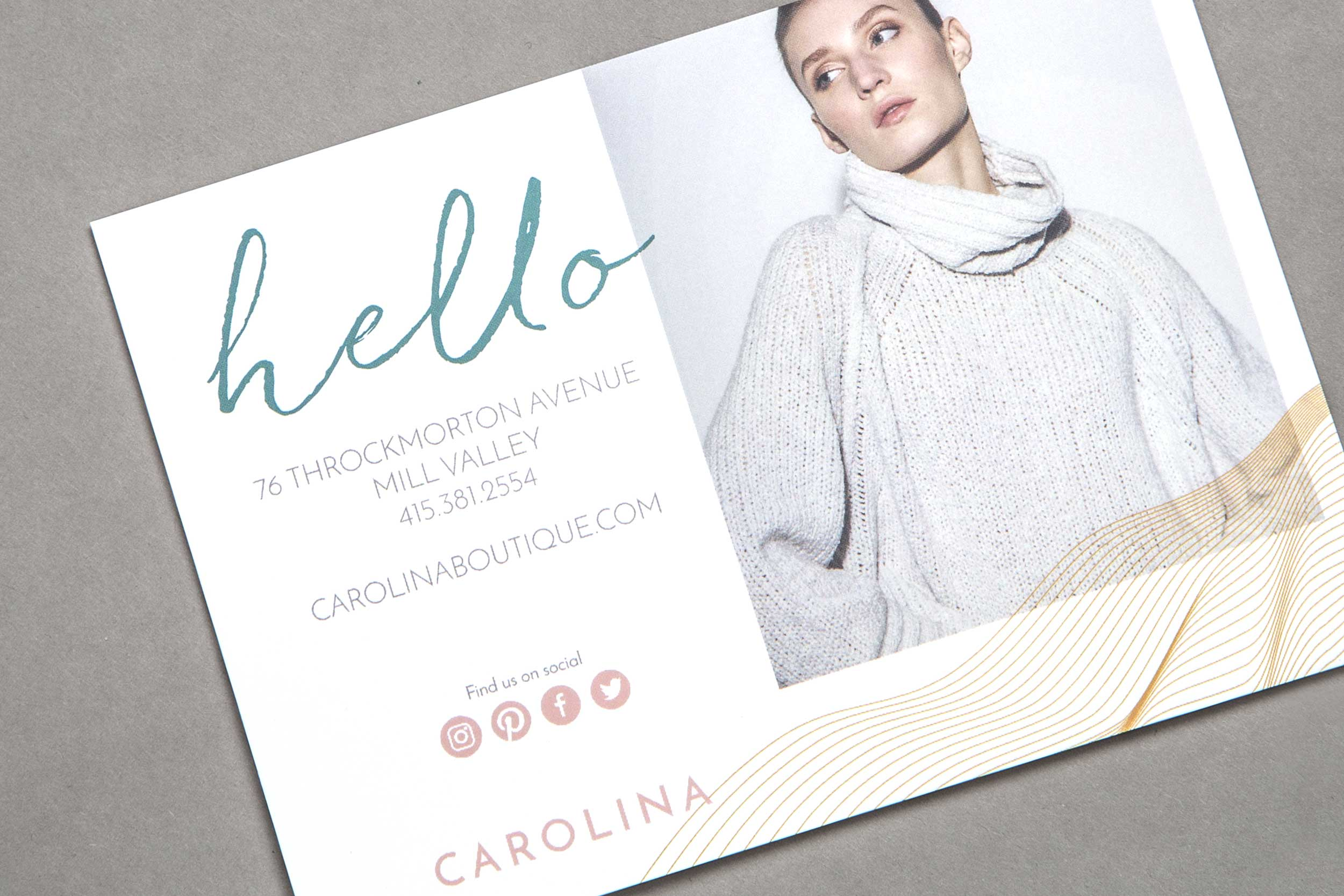 In-store postcard collateral with woman wearing sweater.