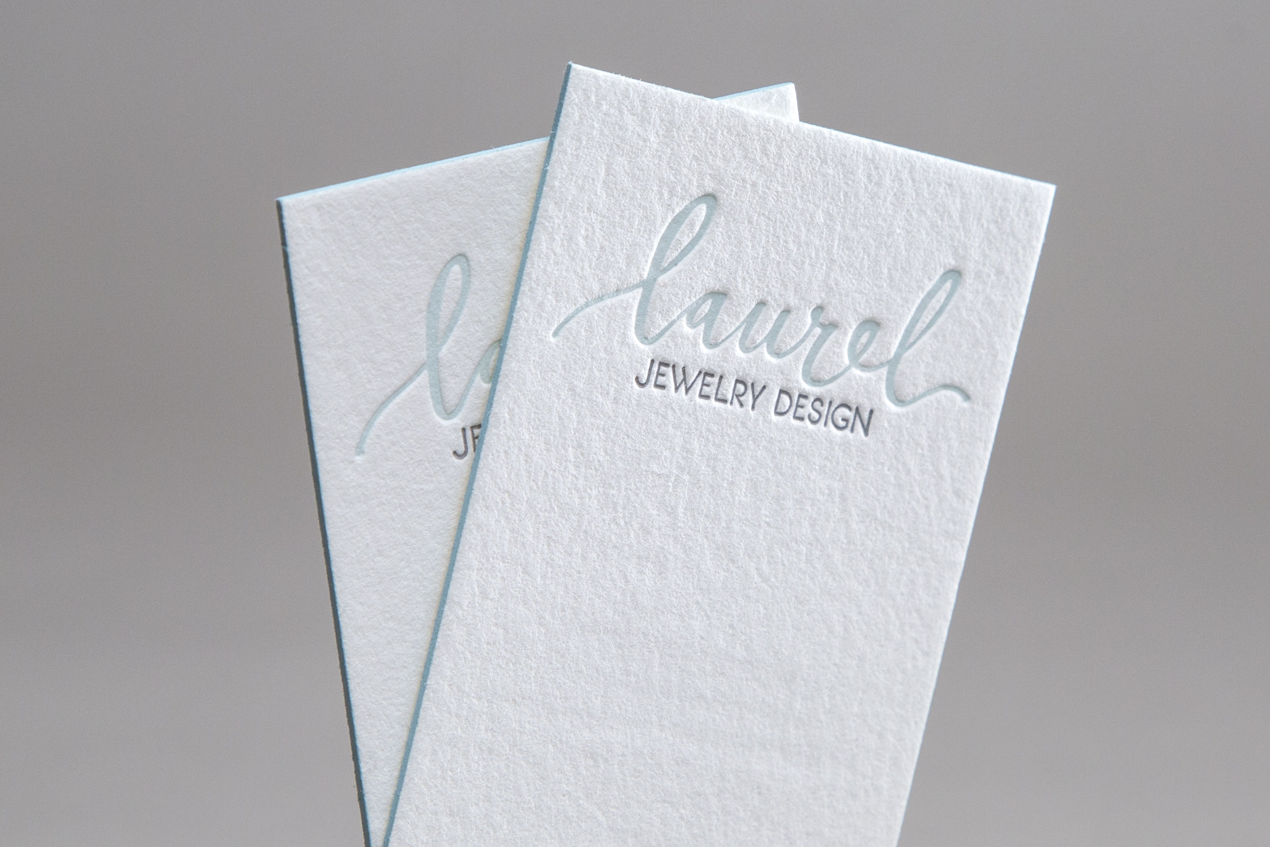 Letterpress business cards with edge printing created by hand for Laurel Jewelry Design.